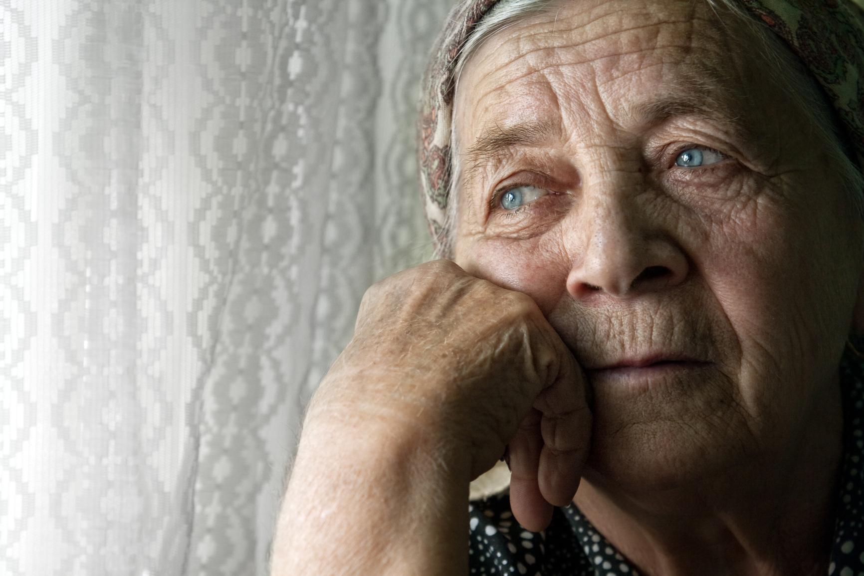 Portrait of sad lonely pensive old senior woman