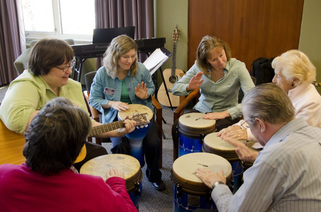 Music therapy group for Alzheimer's patients in George Hall. Betsey King in green.