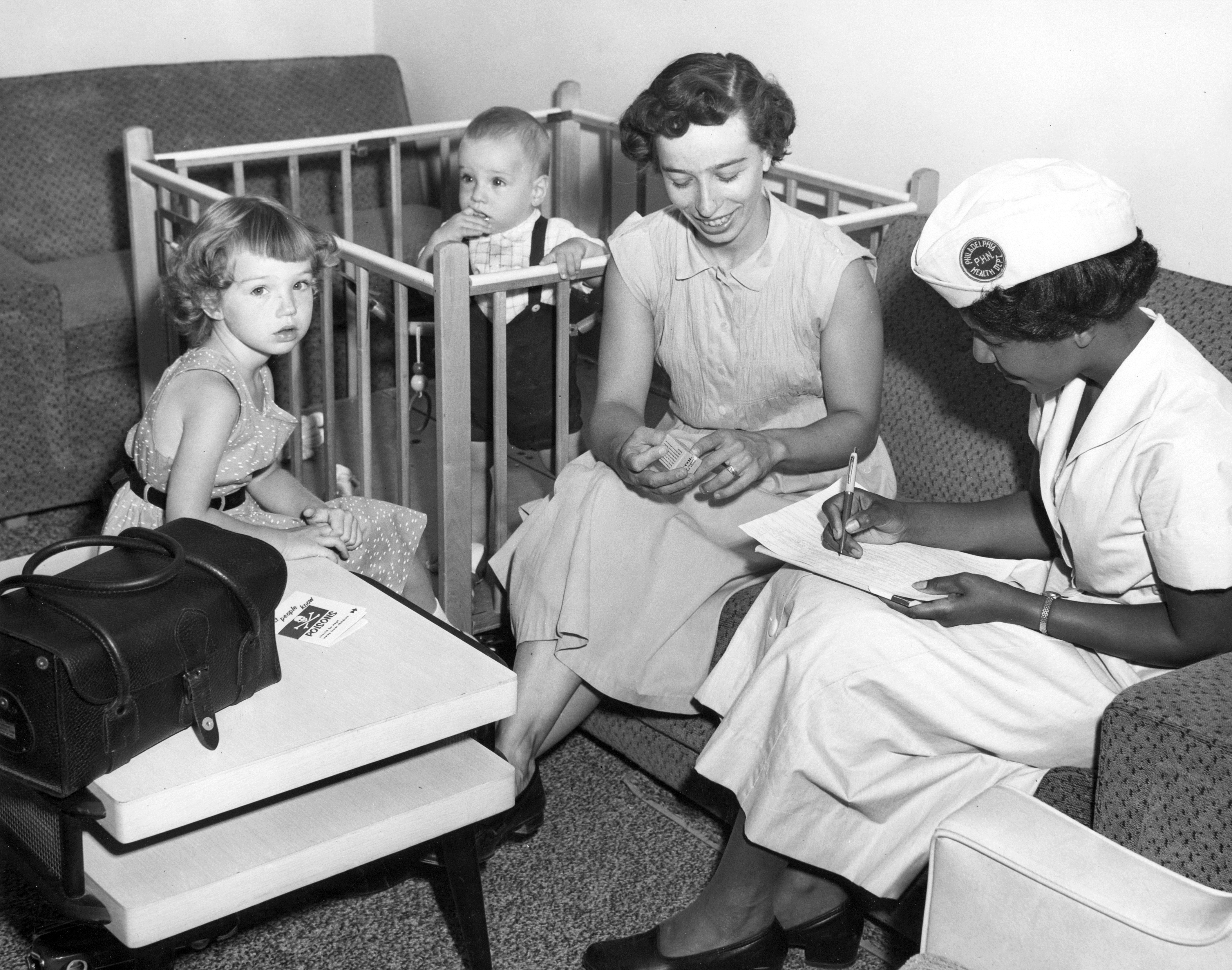 Visiting nurse takes a health history during a home visit, Visiting Nurse Society of Philadelphia,  c. 1957.
