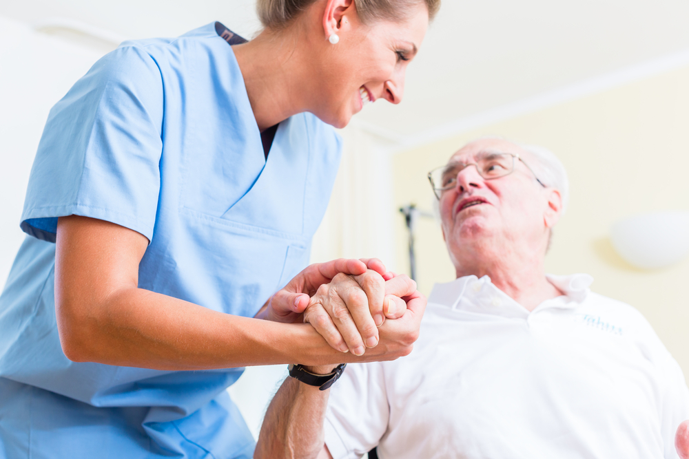Carer_holding_hands_good_care_group (1)