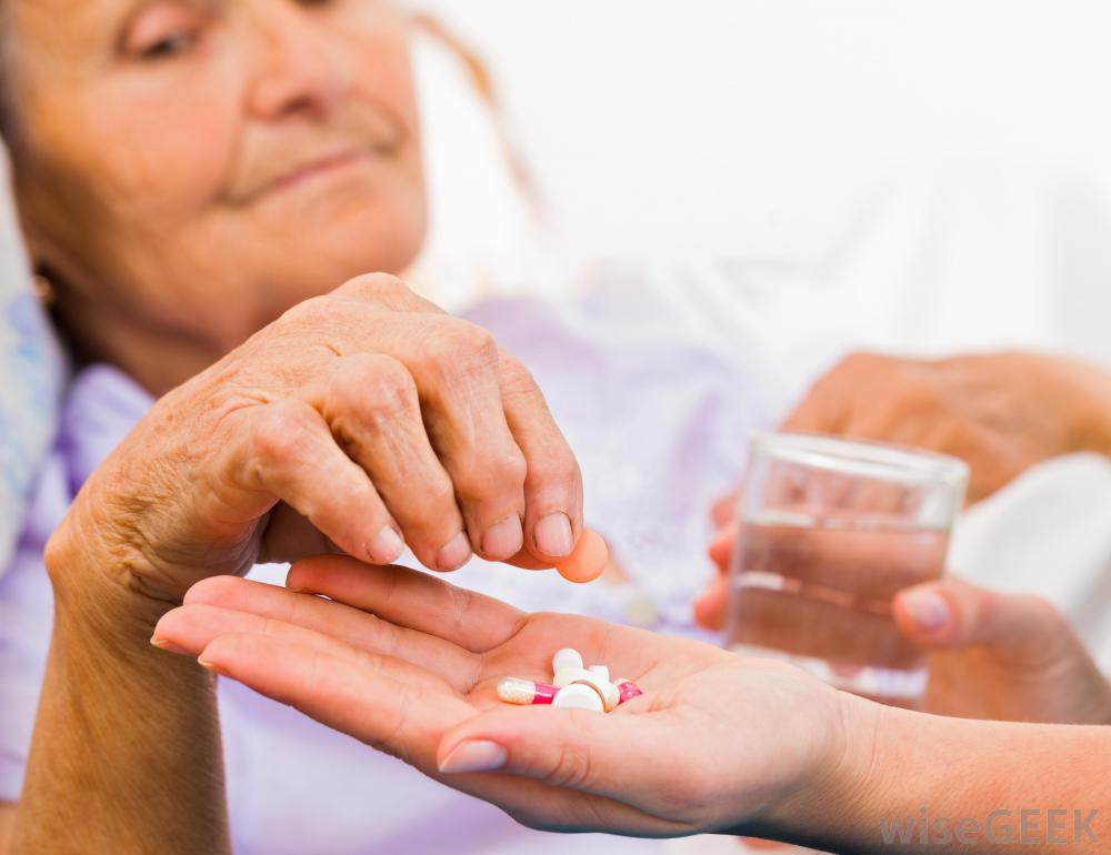 older-woman-taking-pills-from-hand-of-another-woman