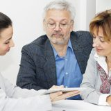Happy mature Couple in Meeting With Advisor.