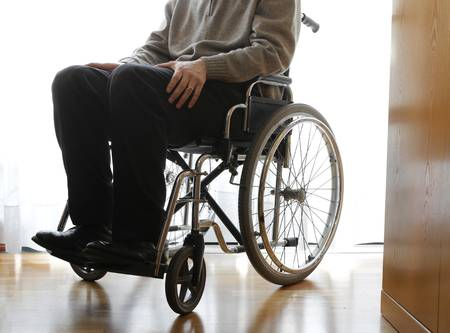 53441152-disabled-elderly-sitting-in-a-wheelchair-in-the-his-room